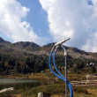 Stock Photo: Ski slope before winter in anticipation of snow, snowmaking nozz