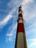 Tall industrial chimney as mast antennas of mobile telephony — Stock Photo