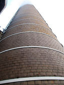 Fragment of an old, tall chimney built of bricks — Stock Photo