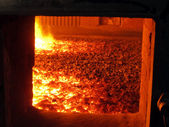 Fire in the boiler furnace grate — Stock Photo