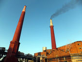 Black smoke coming up from the  brick chimney  — Stock Photo