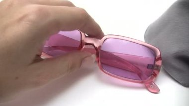 Cleaning Pink Sunglasses — Stock Video