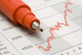 Stock Chart and Red Pen — Stock Photo