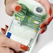 Showing Her Earned Money — Stockfoto