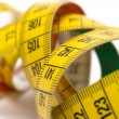 Stock Photo: Winding Tape Measure