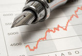 Stock Chart with Fountain Pen — Stock Photo