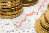 Stock Chart with Stacked Coins — Stock Photo