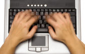 Typing on a Laptop with Motion Blur — Stock Photo