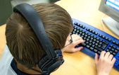 Computer Kid with Headphones — Stock Photo