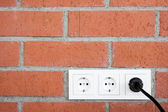 Brick Wall with Power Outlet — Stock Photo