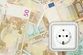 Banknotes and Power Socket — Stock Photo