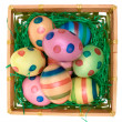 Colored Eggs in a Wooden Basket — Stock Photo #21442415