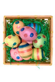 Colored Eggs in a Wooden Basket — Stock Photo