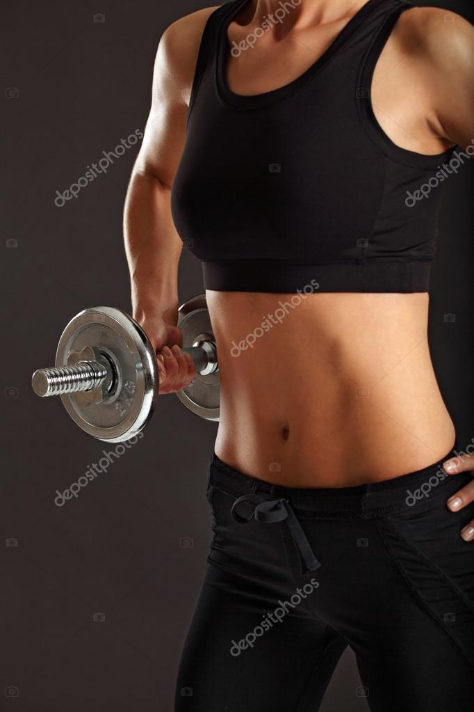 Photo of a toned young female exercising with dumbbells. — Stock Photo #12082962