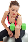 Female doing bicep curls — Stock Photo