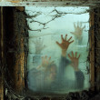 Stock Photo: Zombies outside window
