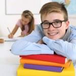Happy student in his classroom — Stock Photo
