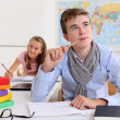 Stock Photo: Student thinking in classroom