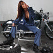 Stock Photo: Sexy female motorcycle mechanic