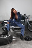 Sexy female motorcycle mechanic — Stock Photo