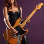 Happy female guitarist — Stock Photo