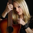 Stock Photo: Sexy blond woman with acoustic guitar