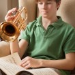 Practicing the trumpet at home — Stock Photo