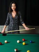 Beautiful brunette playing pool — Stock Photo