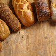 Loaves of assorted bread - Stock Photo