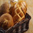 Stock Photo: Loaves of bread in basket