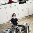 Stock Photo: Playing drums with pots and pans