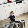 Royalty-Free Stock Photo: Playing drums with pots and pans