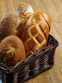 Loaves of bread in a basket — Stock Photo