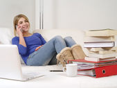 Pretty teenager using smartphone at home — Stock Photo