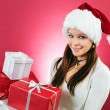 Happy girl holding christmas gifts — Stock Photo