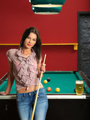Leaning against a pool table — Stock Photo