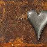 Metal heart on grunge background — Stock Photo #20035387