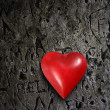 Metal heart on grunge wall — Stock Photo