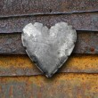 Metal heart on rusty background — Foto Stock