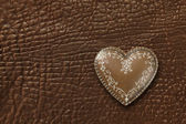 Heart on leather background — Stock Photo