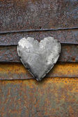Metal heart on rusty background — Stock Photo