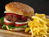 Juicy hamburger and fries — Stock Photo