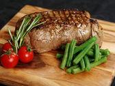 Delicious sirloin steak dinner — Stock Photo