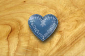 Blue heart on old wood background — Stock Photo