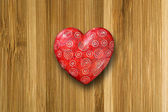 Red heart on old wood background — Stock Photo