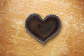 Metal heart on old wallpaper — Stock Photo