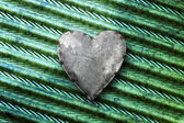 Galvanized metal heart on metal — Stock Photo