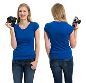 Female with blank blue shirt and camera — Stock Photo