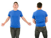 Male with blank blue shirt and outstretched arms — Stock Photo