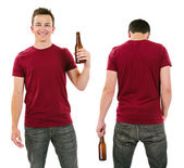 Male with blank burgundy shirt and drinking beer — Stock Photo